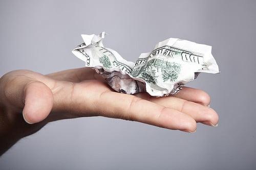 Holding Crumpled Money