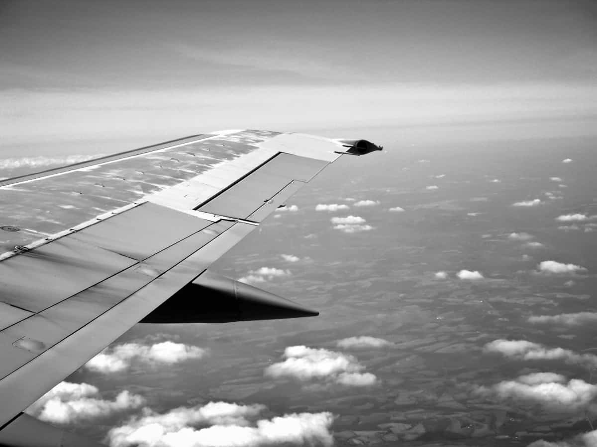 black and white airplane wing view