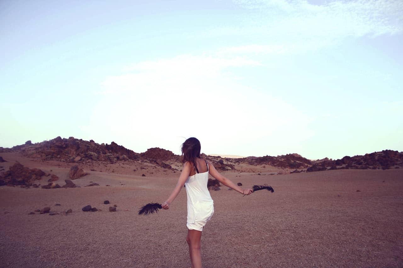 Girl Dancing in the Desert - PersonalProfitability.com